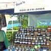 Sue with a display of delicious jams at the Nanaimo Downtown Farmers Market.